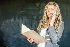 Successful Woman talking on phone. Student Concept of education. And education royalty free stock images