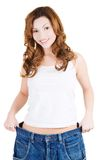 Successful woman in too big jeans Royalty Free Stock Images