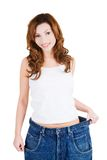 Successful woman in too big jeans Stock Image