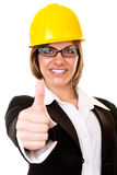 Successful woman with yellow helmet Royalty Free Stock Images