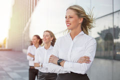 Successful women looking into future with their hands crossed Royalty Free Stock Photo