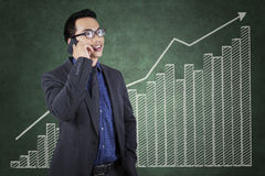 Successful worker with growing financial chart Royalty Free Stock Photography