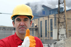 Successful Worker Holding Thumb Up. A portrait of a worker in factory giving thumb up Stock Photography