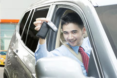 Successful worker holds new car key Royalty Free Stock Photo
