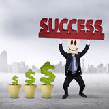 Successful worker with money tree outdoors Stock Images