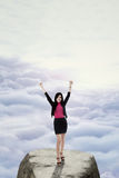 Successful worker standing on the mountain peak Royalty Free Stock Photography