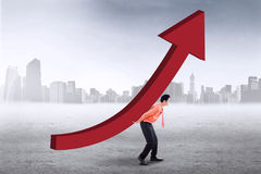 Successful worker with upward chart. Successful businessman carrying upward chart Stock Images