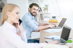 Successful workers are typing on computers Royalty Free Stock Photo