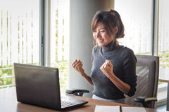 Successful young asian businesswoman with hands up Royalty Free Stock Images