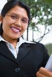 Successful young Asian woman facing camera Royalty Free Stock Image