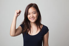 Successful  young Asian woman hold fist up. Royalty Free Stock Photography