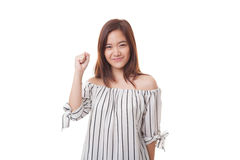 Successful  young Asian woman hold fist up. Royalty Free Stock Images