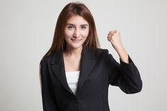 Successful  young Asian woman hold fist up. Royalty Free Stock Image