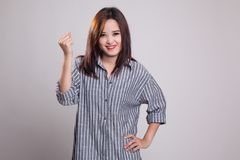 Successful  young Asian woman hold fist up. Stock Images