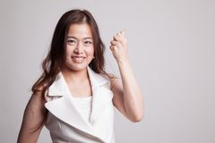 Successful  young Asian woman hold fist up. Stock Photos