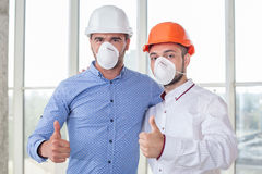 Successful young builders are expressing positive Royalty Free Stock Photography