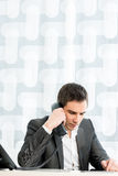 Successful young business executive talking on a phone Royalty Free Stock Images