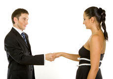 Successful young business executives shaking hands. With eachother in their office Stock Photos