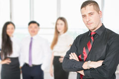 Successful young business man and business team Royalty Free Stock Photos
