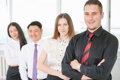 Successful young business man and business team Stock Photos