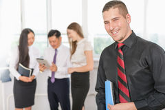 Successful young business man and his business team Royalty Free Stock Image