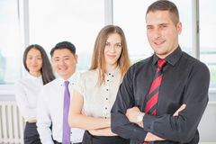 Successful young business man and his business team Stock Images