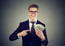 Free Successful Young Business Man Holding Money Dollar Bills In Hand Royalty Free Stock Image - 104068396
