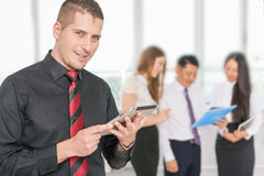 Successful young business man holding tablet pc with his team Royalty Free Stock Photo