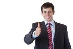 Successful young business man holds thumb up. Stock Images
