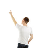 Successful young business man pointing at something interesting. Against white background royalty free stock photos