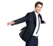 Successful young business man smiling with arms out Royalty Free Stock Images