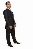Successful young business man standing half-tuned Royalty Free Stock Image