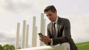 Successful young business man talking on cell phone. Successful handsome young business man talking on cell phone stock footage