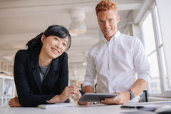 Successful young business partners with digital tablet Royalty Free Stock Photography