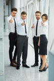 Successful young business people showing thumbs Royalty Free Stock Image