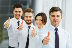 Successful young business people showing thumbs up Stock Photography