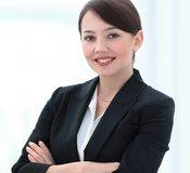 Successful young business woman on the background of the office. stock photo