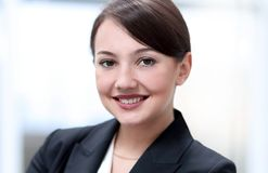 Successful young business woman on the background of the office. royalty free stock image