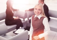 Successful young business woman on blurred background office stock photography
