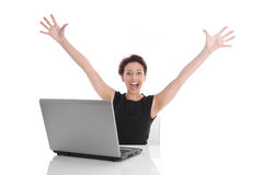 Successful young business woman at desk with computer Royalty Free Stock Photo