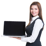 Successful young business woman holding laptop. Royalty Free Stock Photos