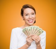 Successful young business woman holding money. Closeup portrait super happy excited successful young business woman holding money dollar bills in hand, isolated Stock Photography