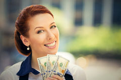 Successful young business woman holding money dollar bills in hand Royalty Free Stock Images