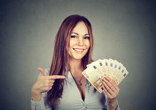 Successful young business woman holding money euro bills in hand Royalty Free Stock Images