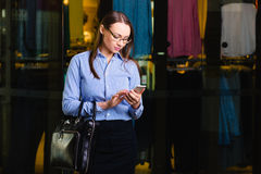 Successful Young Business woman send message,. Busy modern person. successful Young Business woman send message, Walking Inside the Mall. Behind her shop with stock photography
