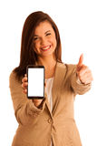 Successful young business woman showing thumbs up as a gesture f Stock Photography