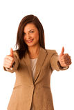 Successful young business woman showing thumbs up  Royalty Free Stock Photo