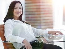 Successful young business woman sitting at workplace stock images