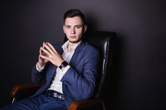 Successful young businessman in business suit and white shirt and fashionable clock. A successful young businessman in a business suit and white shirt and a Stock Photo