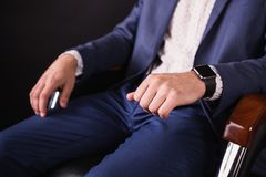Successful young businessman in business suit and white shirt and fashionable clock. A successful young businessman in a business suit and white shirt and a Stock Image